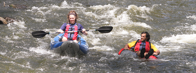 students kayaking and tubing on river