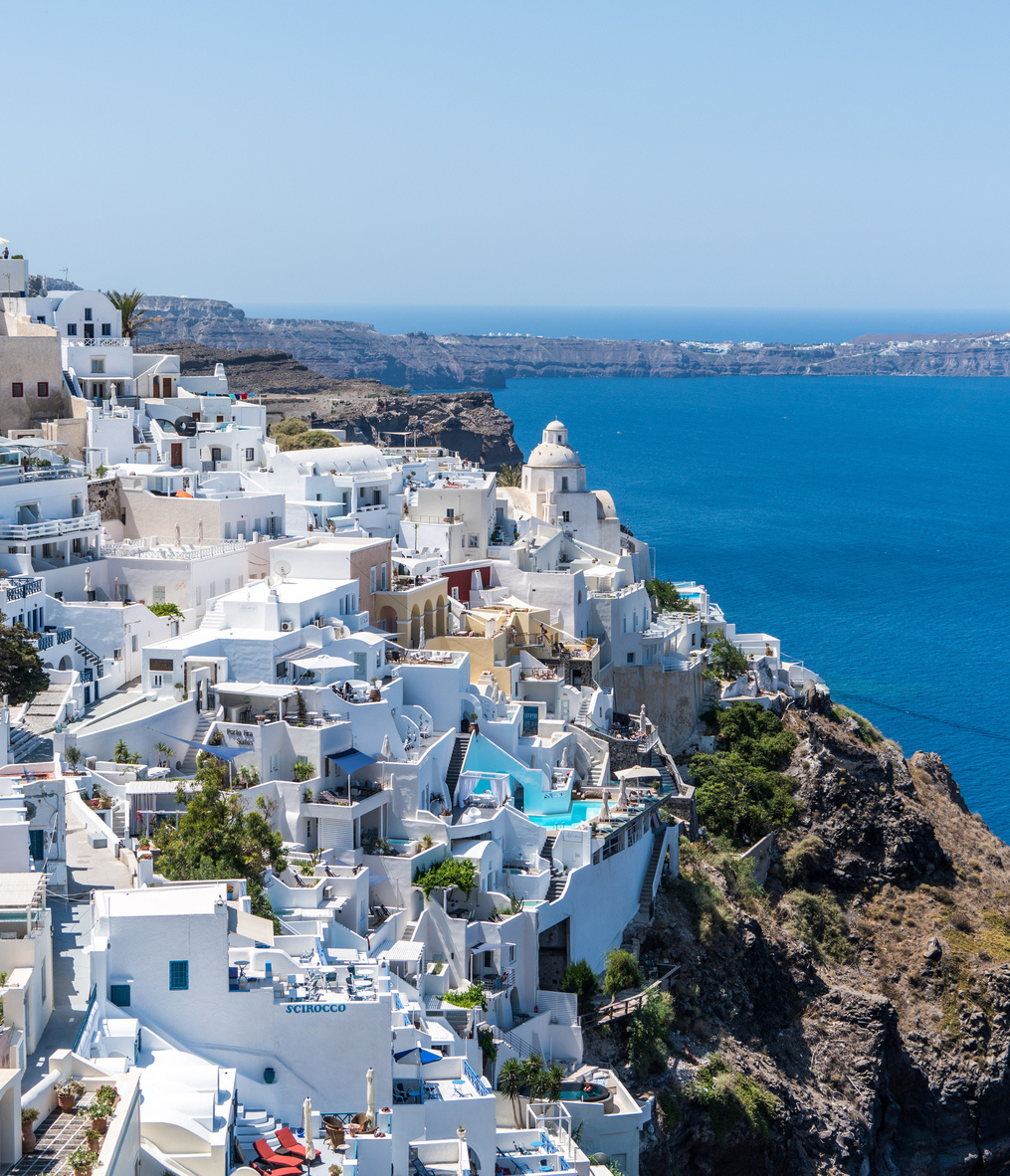 Buildings overlook the water in Greece.