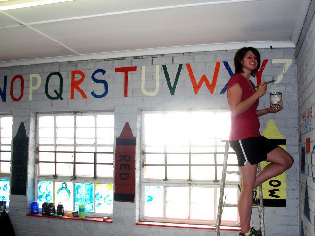 Sara painting classroom walls in South Africa