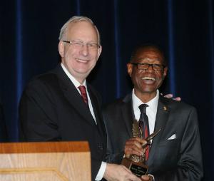 Dr. Lefton presents Mr. Gene Shelton with the 2013 Diversity Trailblazer Award