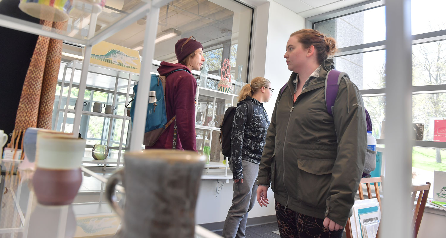 Students learn the marketing and business side of art by working at the new ARTshop.