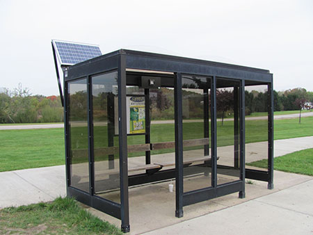 A solar-powered panel is providing LED lighting for a Kent Campus bus shelter located near the east end of Summit