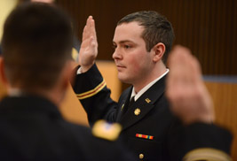 John Richards takes the oath of office during his commissioning as a second lieutenant.