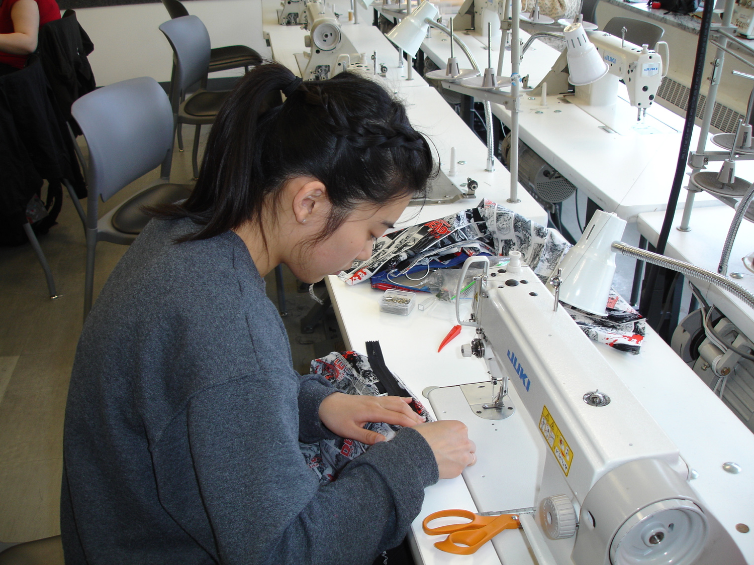 Student sewing during FSStore Sew-a-thon