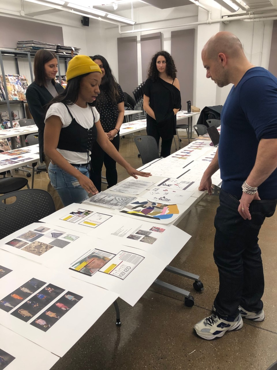 student showing portfolio to mentor
