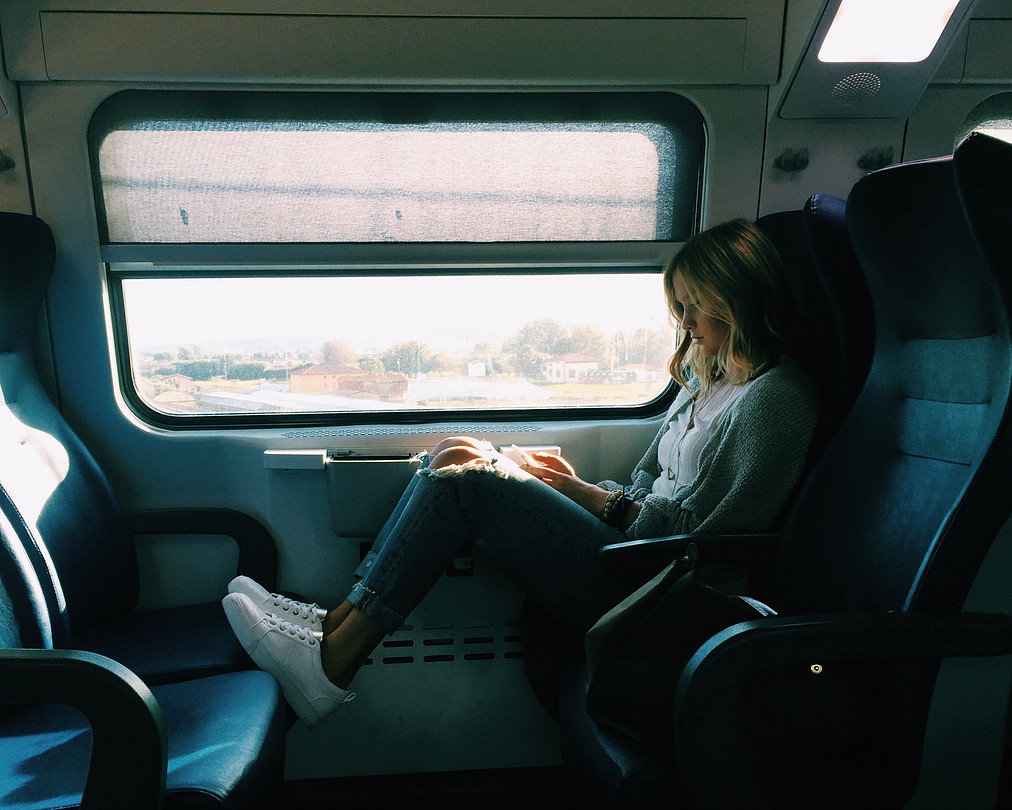 """""""Traveling reminds us of how lucky we are and how special it is that we can come """"home"""" to Florence feeling positive and motivated for the week ahead,"""" writes Ellie Stiles (Hudson, Ohio). She took this photograph of roommate Summer Szaz (Loveland, Ohio) on a train heading back to Florence after a day trip in Lucca, Italy. Photo by Ellie Stiles"""