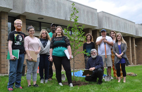 Planting a tree to celebrate Arbor Day on the Kent State Salem Campus