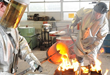 foundry students pouring molten metal