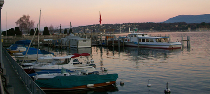 Boats on a river in Geneva, Switzerland
