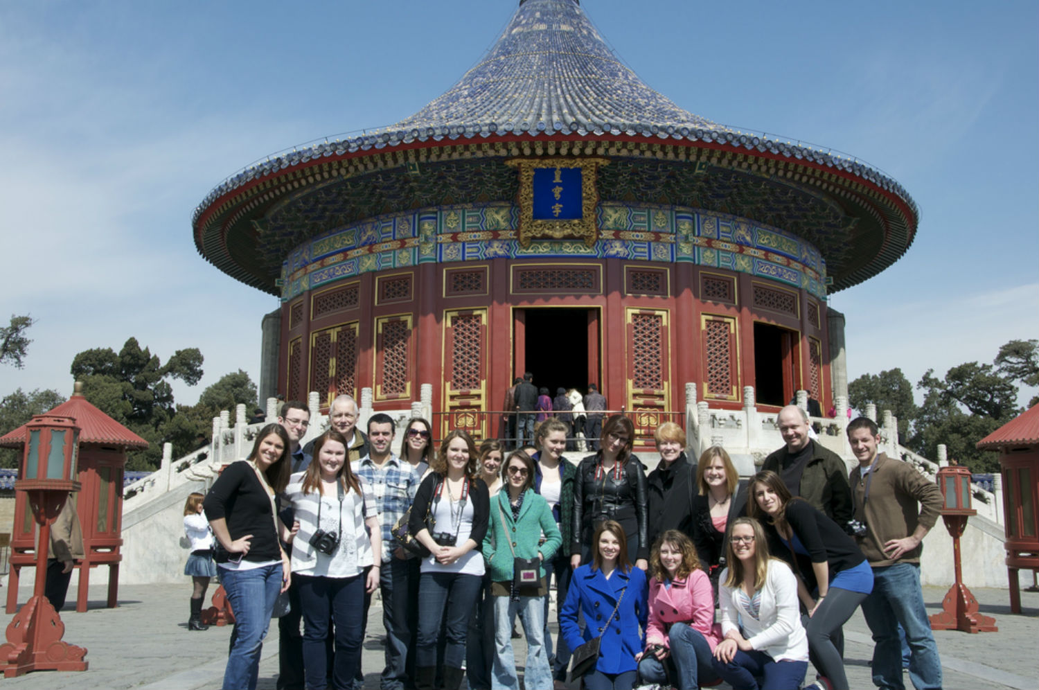 Group of students, gathered together posed and smiling for the camera in Asia
