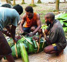 Solomon Islanders prepare a feast in the South Pacific.