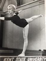 Joan Ganim balancing on a balance beam