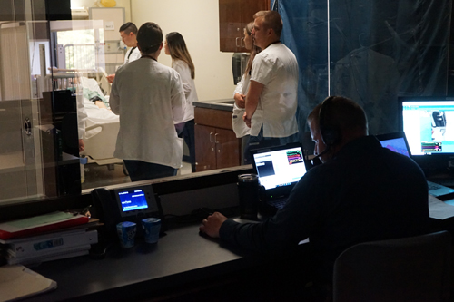 Jeremy Jarzembak acts as the simulated patient from the control room