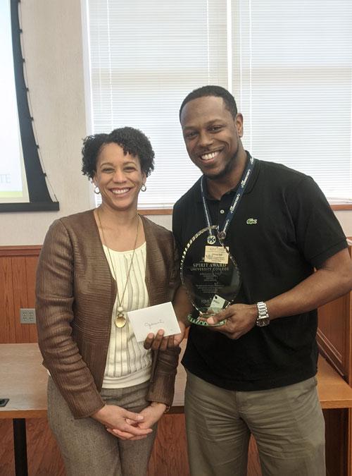 Jimmal Ball, winner of the Spirit of UC Award, with Dean Eboni Pringle