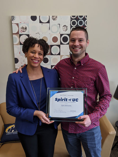 Kyle Delarenko, winner of the Spirit of UC Award for Graduate Students, with Dean Eboni Pringle