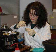 Dr. Mary Ann Raghanti sectioning a piece of human brain in her histology lab.