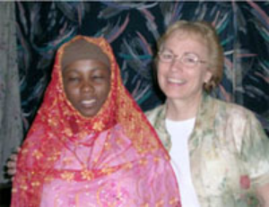 Joy St. James and a Somali Bantu refugee.