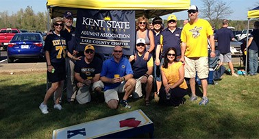 Lake County Chapter alumni and friends enjoy a tailgate before a Golden Flash football game.