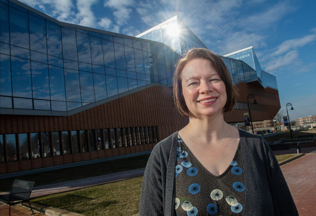 Melanie Knowles, Sustainability Manager, stands in front of Kent State LEED Platinum building, The John Elliot Center for Architecture and Environmental Design.