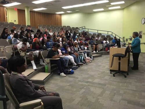 A group of students from the Martin Luther King, Jr. Career Campus take part in a presentation about nursing in Henderson Hall