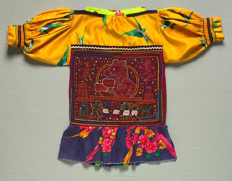 Woman's Blouse with a Pair of Molas, a Boxer and Spirit-like Animals