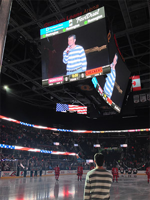 Ridinger singing the National Anthem before a Cleveland Monsters hockey match