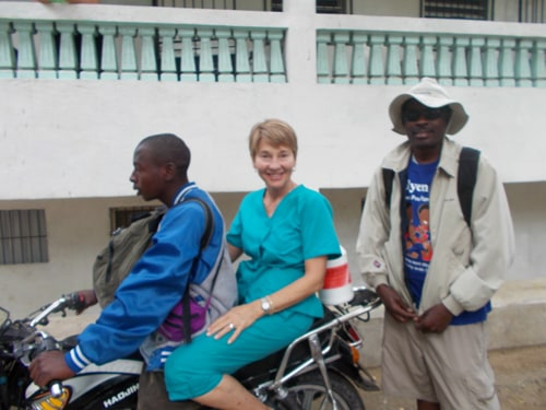 Brook Borgeson Gray rides a motorcycle to the Hatian mountain villages with a Hatian medical team