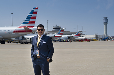 Mr. Belluardo poses for a photo outside of Cleveland Hopkins International Airport.