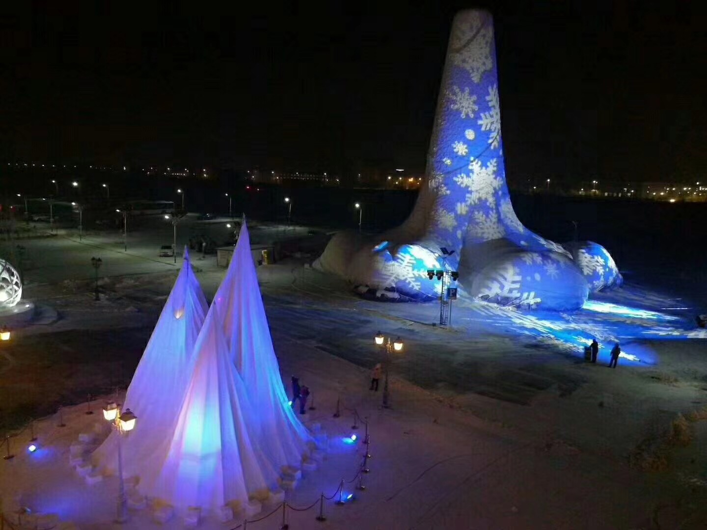 The final sculpture, consisting of three ice spires, is illuminated in Harbin, China.