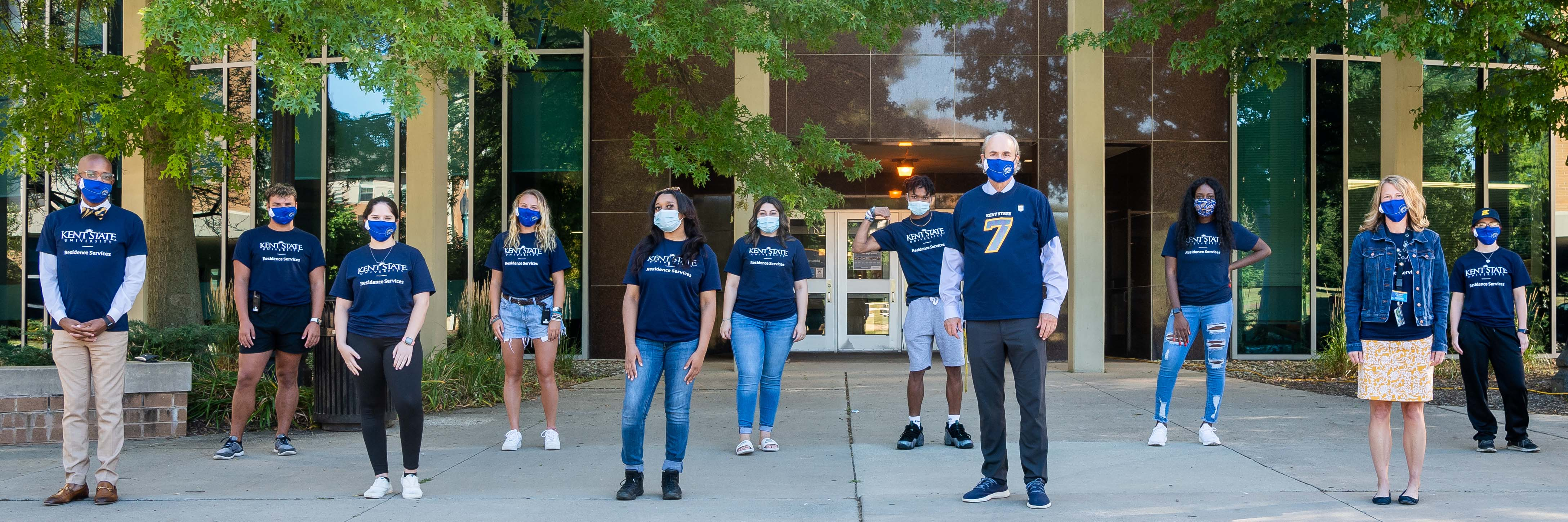 President Todd Diacon prepares for move in with student, faculty and staff volunteers wearing masks and socially distanced during the COVID-19 pandemic.