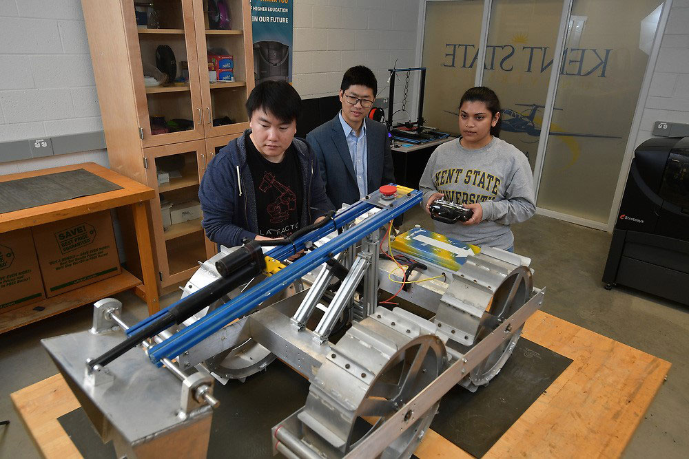 Image of students with robot