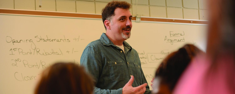 Prof. Jim Canacci moderates an in-class debate