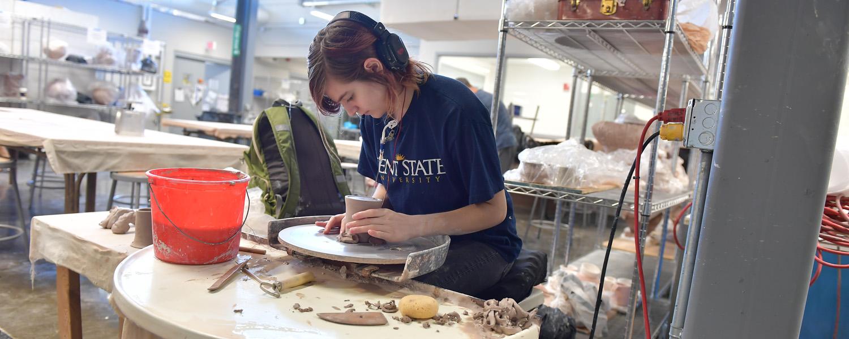 Ceramics student working on the wheel