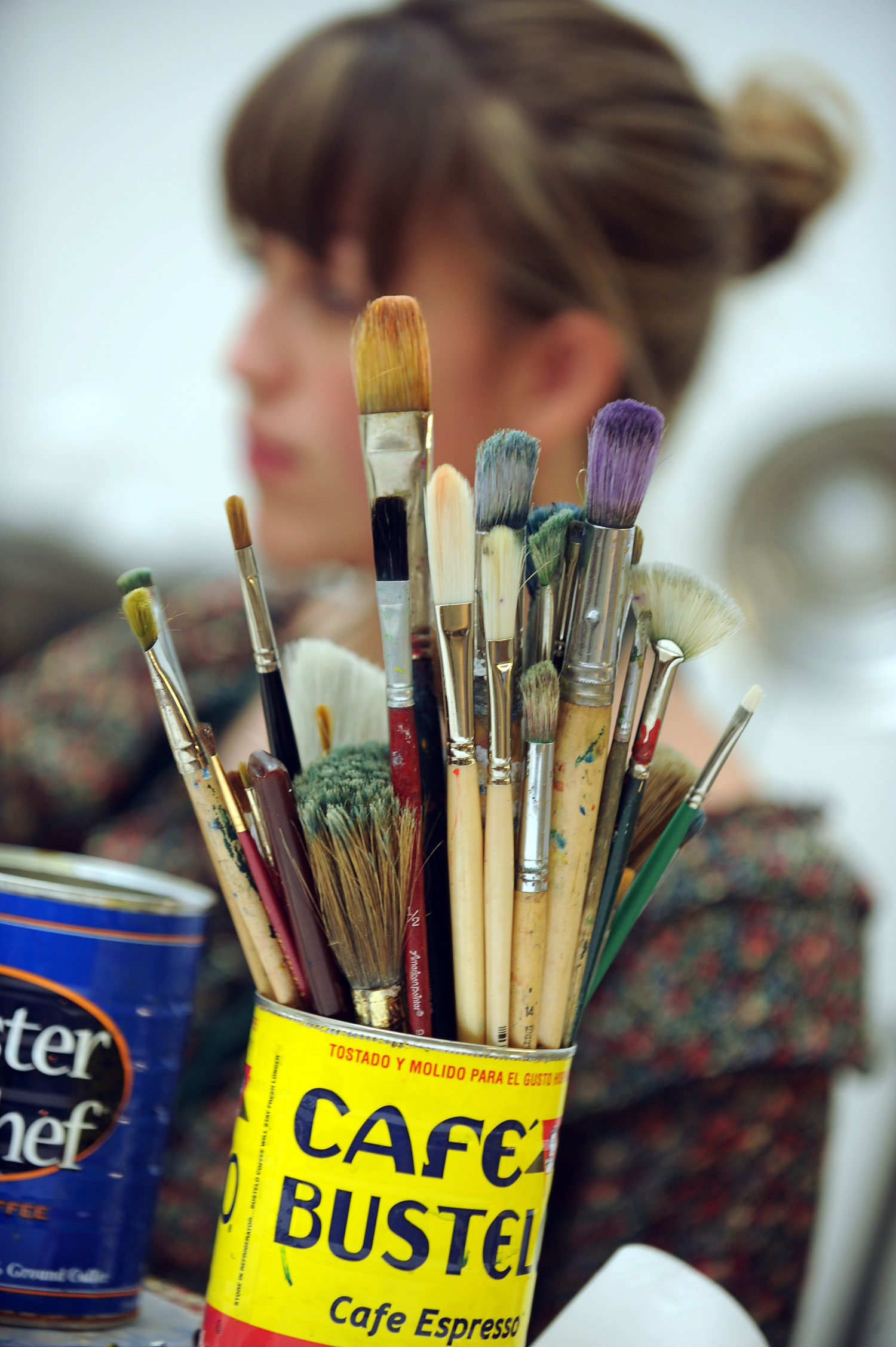 An art student works on her painting in the Art Building.