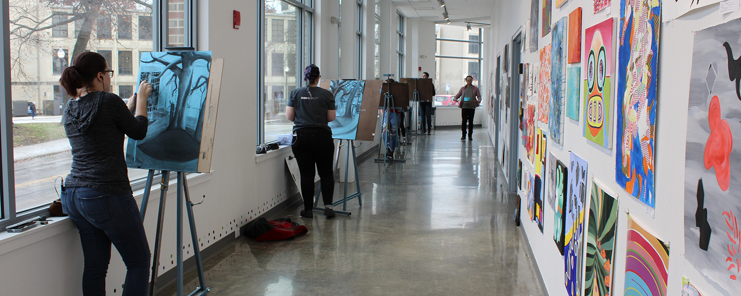 Students drawing in the hallway in the Center for the Visual Arts