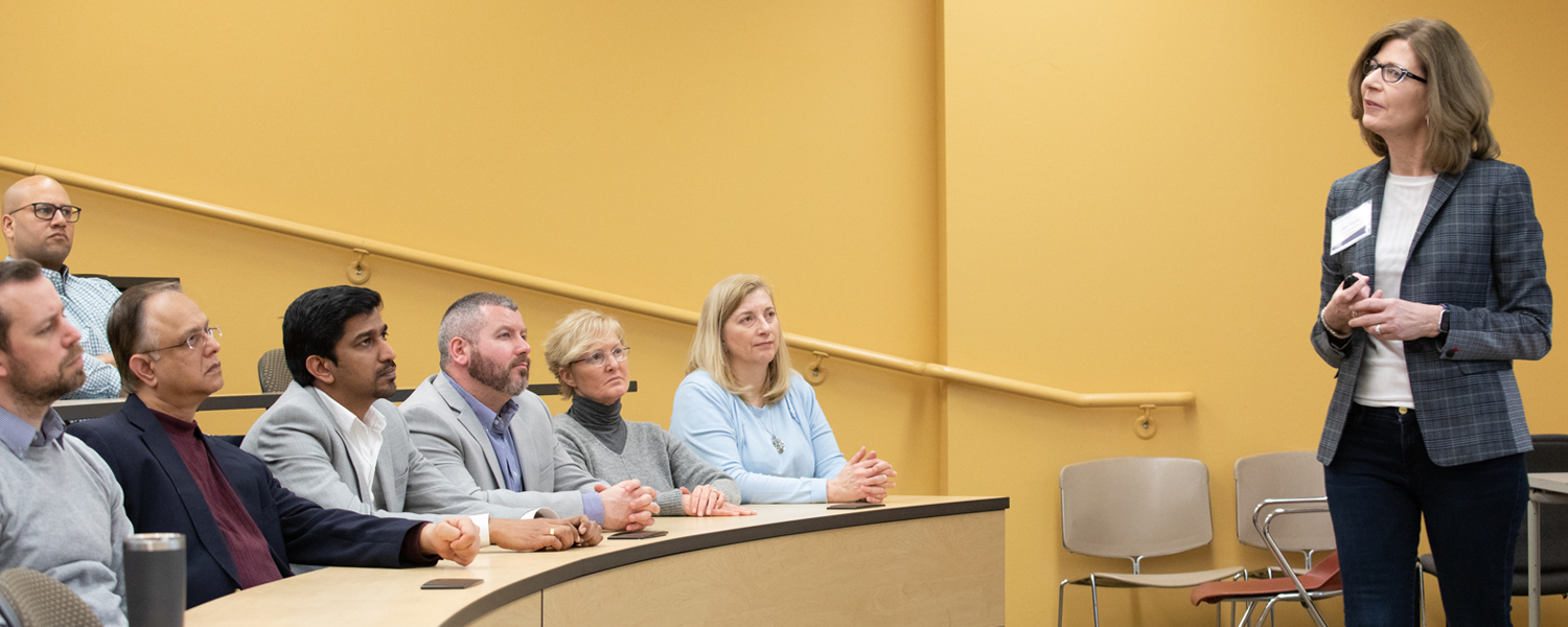 EMBA students and instructor in class