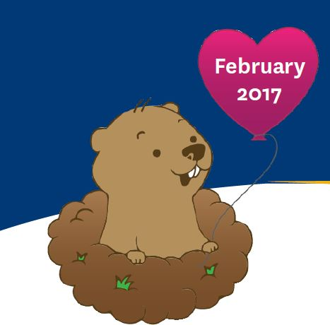 Groundhog holding a heart balloon