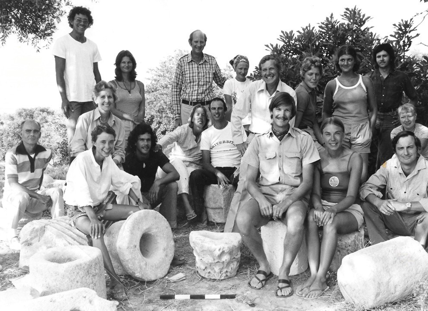 The Kent State dig crew in Cyprus in 1976 or 1977. Holly Morris is in the middle, wearing a white shirt. Jim Carpenter, professor in the Classics, the director of the dig is the tall guy in the back (middle). Dr. John and Betty Parks are on the far left.