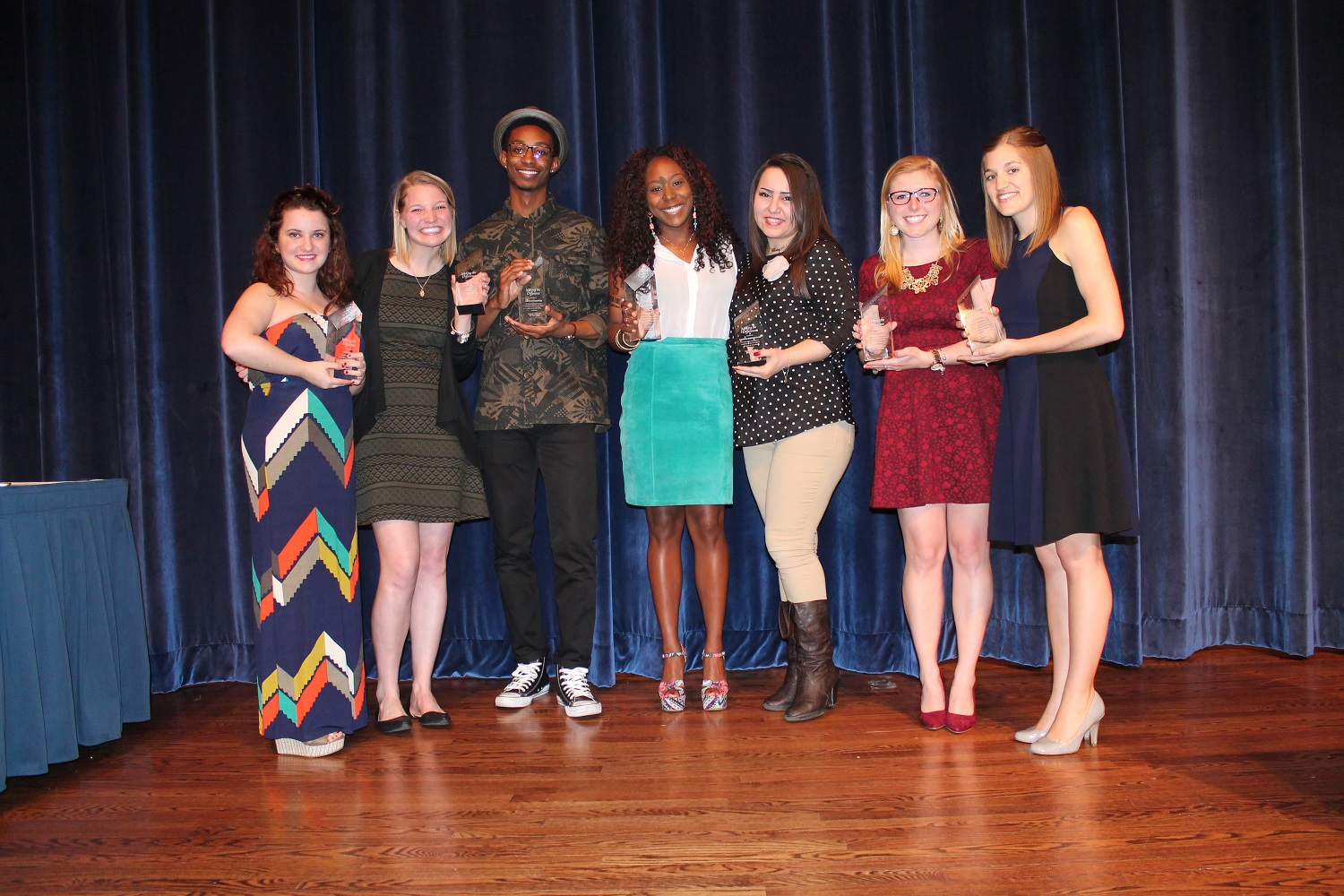 A group of students accept their leader of the year awards.