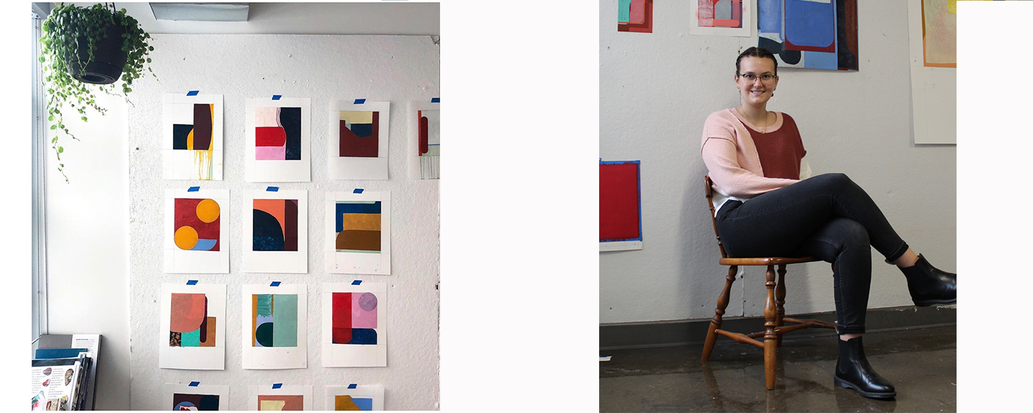 Graduate student in a painting studio sitting in a chair. Artwork hanging on the wall beside her.