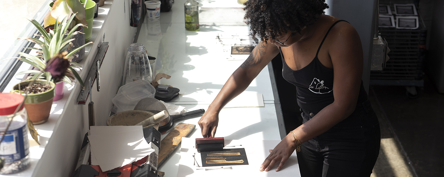 Student using the print studio