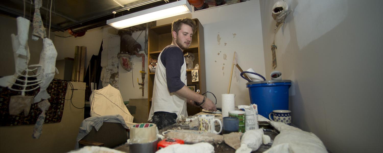 Sculpture student working in his studio