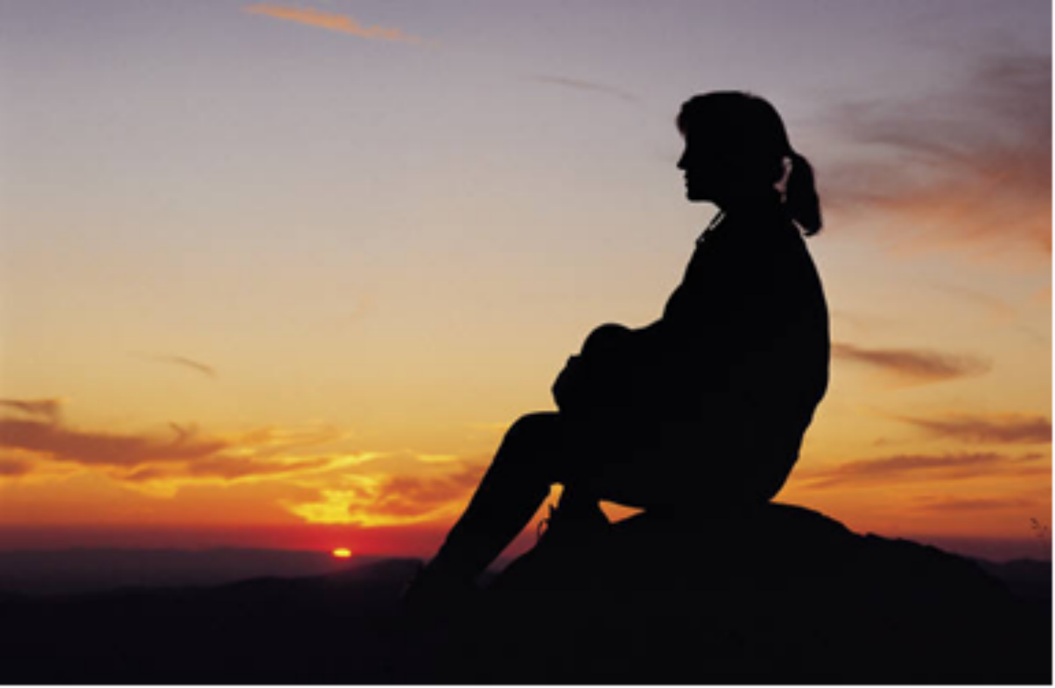 Image of person during sunset thinking. Psychological Services: All contact with staff is strictly confidential.
