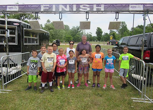 Beatty with his 4th grade students at the Tuscarora Indian School Fun Day event.