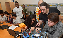 Computer Engineering Technology faculty member Evren Koptur instructs students