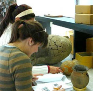 Student working on a ceramics project in the archaeology bench lab.