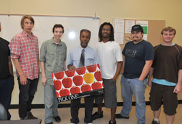 Professor George Garrison of the Department of Pan-African Studies poses with some of his students.