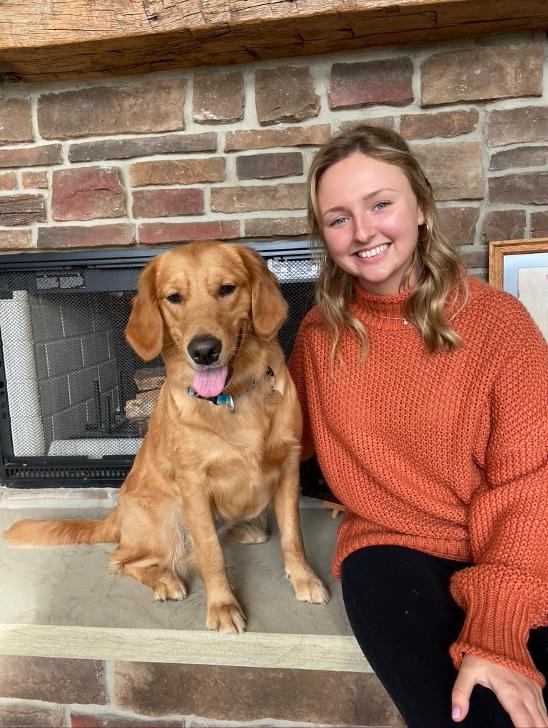 image of Rebecca Cybulski and golden dog