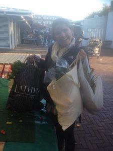Kent State senior Erin Shattuck holds bags full of food she rescued for an alternative market in Australia.