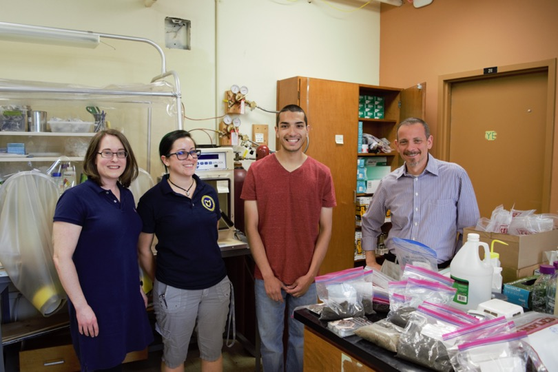 Kent State associate professors Bridget Mulvey (far left) and David Singer (far right) are pictured with Kent State Department of Geology graduate students Lucy Dyer and Nicholas Santoro in Singer's Environmental Mineralogy and Geochemistry Laboratory.